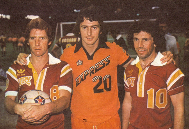 Alan Ball (L), and Johnny Giles (R), with Detroit Express forward Trevor Francis. Photocourtesy of NASLjerseys.com.