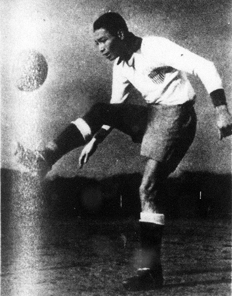 Gil Heron kicking soccer ball