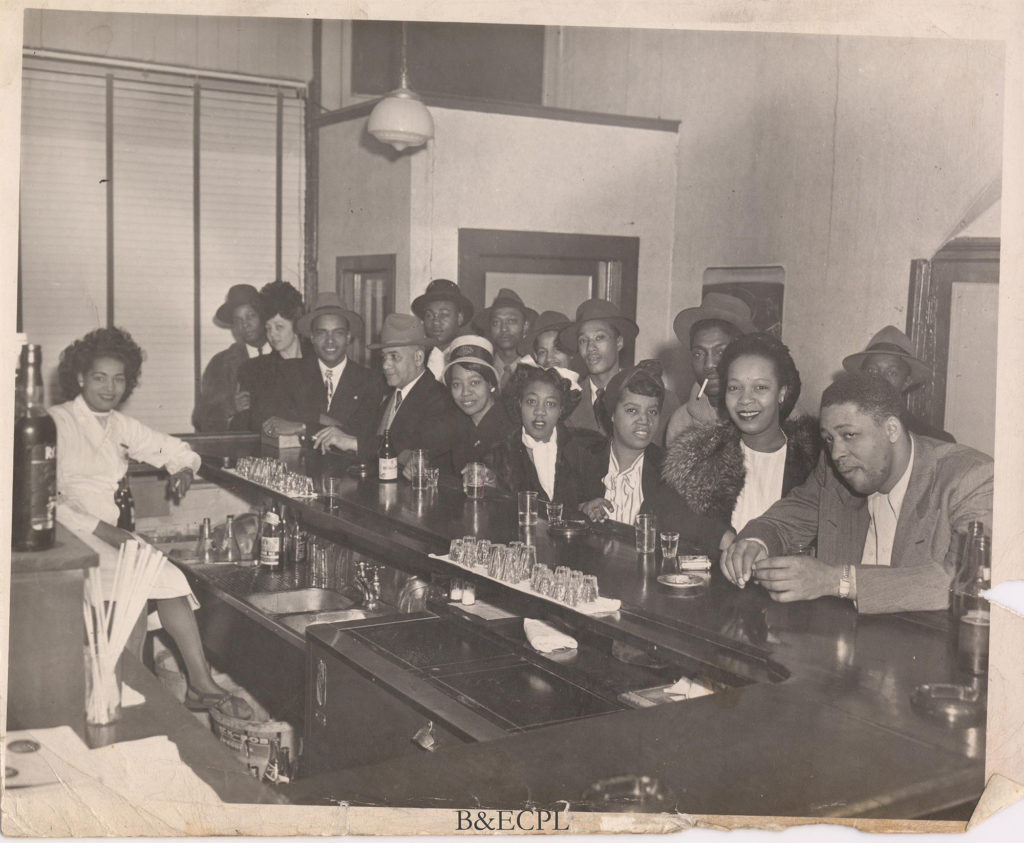Men and women at a bar